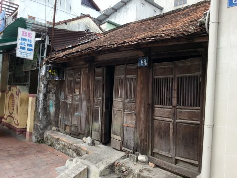 Old wooden shop house on Bach Dang Street