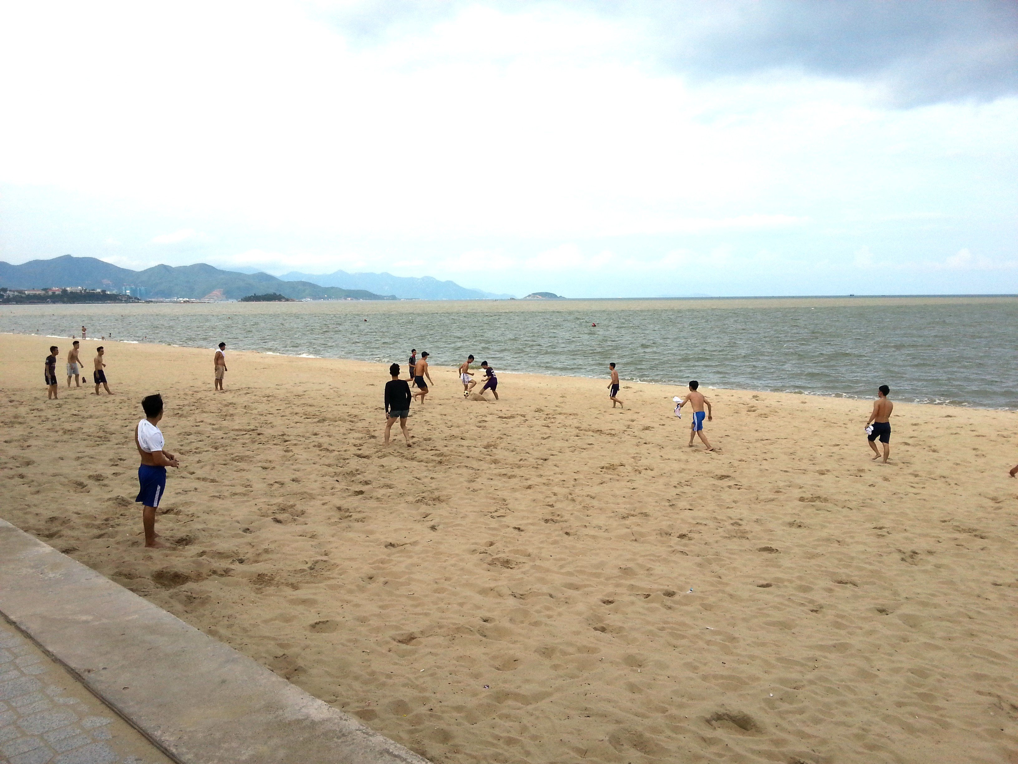 Locals playing football on Nha Trang Beach