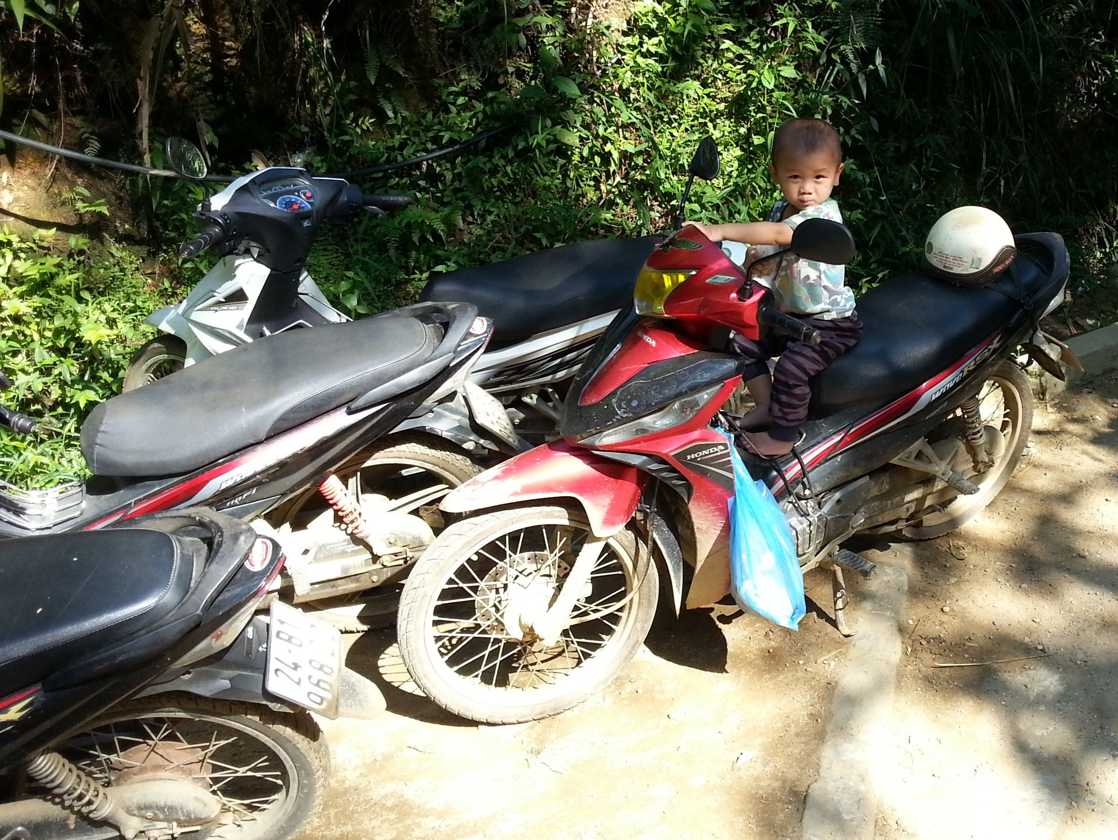 Motorbike taxis operate from the other side of Cat Cat Bridge