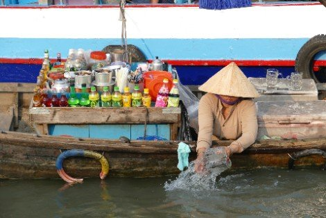 Market trader on a boat in Can Tho